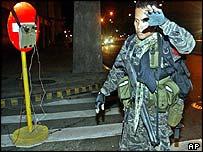 Rebel soldier near 'bomb'