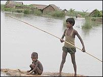 Children negotiate the Sundarbans by raft. Picture by Subir Bhaumik
