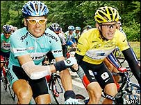Runner-up Jan Ullrich congratulates winner Lance Armstrong during the final stage