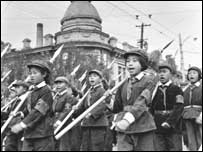 On National Day 1966, schoolchildren carrying spears and wearing Red Guard armbands parade through the streets ( photograph courtesy of Li Zhensheng/CONTACT Press Images )