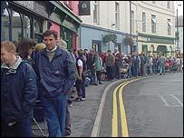People queue in Carmarthen