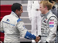 Juan Pablo Montoya shakes hands with Kimi Raikkonen after the Monaco Grand Prix