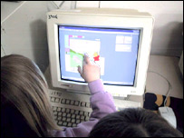 Children playing with computer