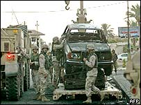 US troops removed destroyed cars