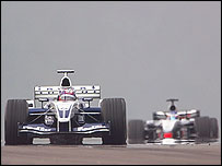 Juan Pablo Montoya leads Kimi Raikkonen at the European Grand Prix