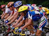 Riders bunch together during a road race