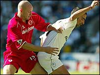 Danny Mills (left) and Youri Djorkaeff go toe-to-toe