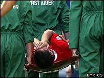 Liverpool striker Milan Baros is stretchered off in agony with a broken ankle