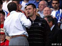 Blackburn Rovers manager Graeme Souness is seperated from Liverpool manager Gerard Houllier by the fourth official