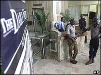 Guards at the offices of the Daily News