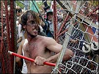 Protesters break down fence in Cancun