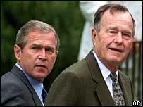 George W Bush (l) and father George Bush (r)