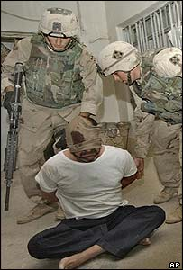 US soldiers guard the suspected bodyguard