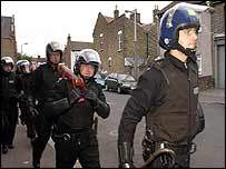 Police prepare to raid a home in Stratford in east London