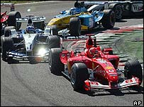 Michael Schumacher stays ahead of Juan Pablo Montoya on the first lap