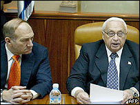 Israeli Deputy Prime Minister Ehud Olmert (L) and PM Ariel Sharon at Sunday's cabinet meeting