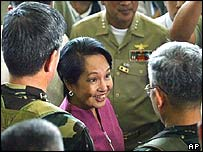 Philippine President Gloria Macapagal Arroyo smiles as she thanks government troopers for their support