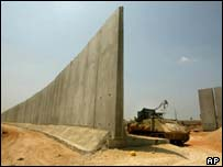 The newly-built concrete and steel wall separating the Palestinian West Bank town of Qalqilya from Kfar Saba in Israel