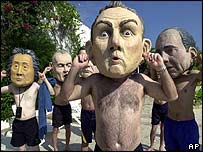 World leaders shut their ears to the poor, say protestors at the September 2003 World Trade Organization meetings in Cancun, Mexio.