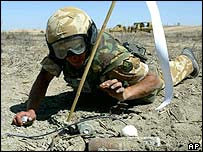 British soldier clears a mine in southern Iraq