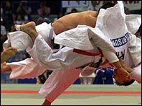 Judo competitors in action