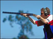 A competitor takes part in trap shooting