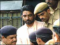 Indian Ravindra Pal alias Dara Singh arrives at a special court in Bhubaneshwar