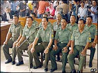 Ten Indonesian military officers sit in the dock in Central Jakarta District Court in Jakarta