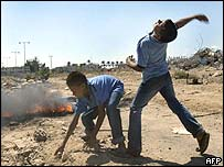 Palestinian boys throwing stones at Israeli soldiers guarding an Israeli settlement in the  Occupied Territories
