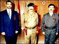 Saddam Hussein (centre) pictured with Uday (left) and Qusay