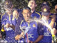 Hollioake sprays the champagne