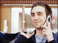 A man speaks on his mobile phone
