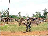 A soldier from the Union of Congolese Patriots stands in the deserted town of Nyakunde, two months after the massacre