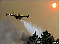 Fire-fighting plane drops water