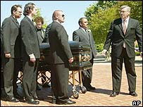 Johnny Cash's coffin is taken into the church