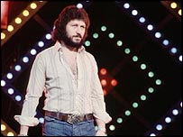 Dave Lee Travis hosting Top of the Pops in the 1970s