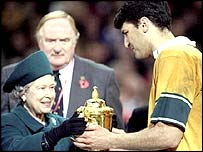 John Eales receives the World Cup trophy from the Queen