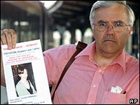 Philip Kerton in Germany with a poster for missing Louise