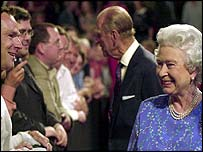 The Queen and Prince Philip greet some of the music fans during an interval