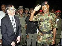 Nigeria's Brigadier General Festus Okonkwo salutes US Ambassador John Blaney