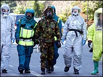 People wearing protective suits