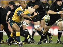 George Gregan makes a pass against New Zealand