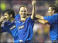 Scorers Christian Nerlinger (centre) and Peter Lovenkrands celebrate