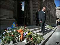 Prime Minister Goeran Persson stands by tributes on the steps of parliament