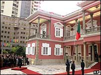 The Portuguese national flag is lowered for the last time at the Macau Government Palace