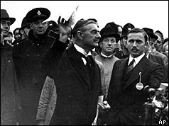 PM Neville Chamberlain arriving at Heston airport with the non-aggression pact in hand