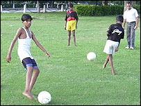 Street children play soccer in Delhi. Photo by Ayanjit Sen
