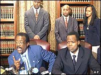 Johnnie Cochran (left, seated) and complainants