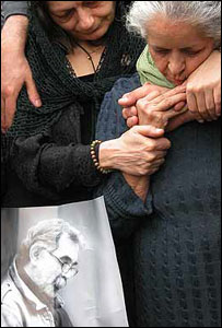 Hengameh (left) and Kaveh's mother at his funeral.
