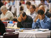 Attendants of the Episcopal General Convention praying before the debate began